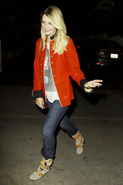 A makeup free Mischa Barton kept her look casual at Chateau Marmont in a pair of tan buckled boots.