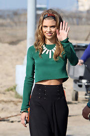 AnnaLynne McCord wore a unique ivory necklace over her green crop top for filming '90210.'