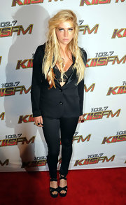 Kesha struck a serious pose on the red carpet in black suede double crisscross sandals.