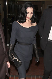 Dita Von Teese was ahead of the leather glove trend in this classic elbow-length pair.