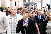Teen heart-throb Justin Bieber leaving his Paris hotel amidst a flurry of female fans wearing a 'Stewie' pendant from the US cartoon