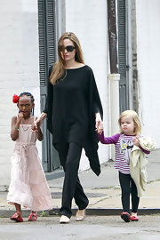 Angelina Jolie stuck to her all black uniform, wearing a black tunic top with matching pants.