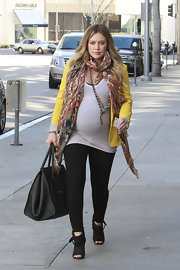 Hilary Duff accessorized her street style with cutout ankle booties.