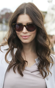 Jessica Biel attended the Valentino spring/summer fashion show in Paris with her long hair in soft waves.
