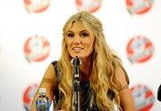 Delta Goodrem wore her long waves in a boho-chic half-up half-down style at a press conference for 'The Voice.'
