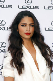 Camilla Alves styled her lustrous locks in soft curls at the Casino de Madrid event.