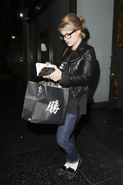 Kelly wore patent-trimmed loafers with cuffed jeans and a motorcycle jacket while dining at Katsuya.