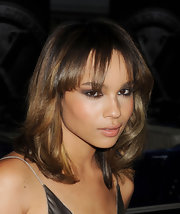 Zoe Kravitz styled her hair in loose curls with wispy bangs that fell just above her eyes.