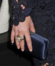 Rose Bryne paired her lace dress with a gold and diamond cocktail ring at the premiere of 'X Men: First Class.'