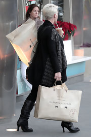 A pregnant Pink hit the Santa Monica shops wearing a pair of slouchy leather knee high boots. The boots feature round toes and buckle embellishments.