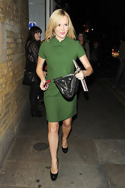 Amanda Holden carried her necessities in a sparkly clutch as she left the Donmar Theatre in London.