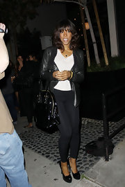 Kelly Rowland looked chic at STK carrying an oversize black patent bowler bag.
