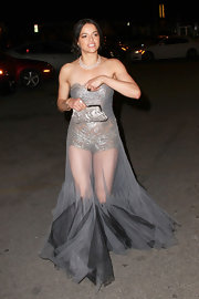 Michelle Rodriguez accented her sheer Marchesa gown with a snakeskin frame clutch with silver hardware.