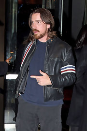Christian Bale jumps on the leather trend with added stripe details.
