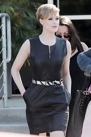 Evan Rachel Wood looked rocker-chic in a black leather zip-up dress with a zebra striped belt and a short pixie cut.