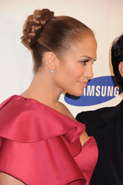 Jennifer Lopez exuded chic elegance with a sophisticated braided bun. She fastened her bun at the crown and twisted her braid around her ponytail.