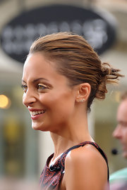 "Nicole chose a twisted bun for her look at 'Extra.""'"
