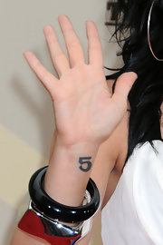 Claude showed off her number 5 tattoo while hitting the premiere of 'Camp Rock 2:The Final Jam'.