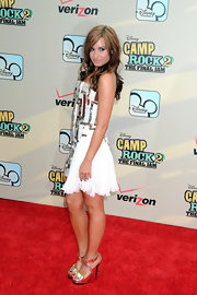 Demi paired her sparkling white cocktail dress with the metallic Cindy sandals.