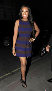 Jennifer Hudson gave her striped frock an unexpected finish with black patent leather and mesh peep-toe booties.