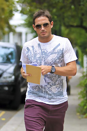 Frank rocks his aviator sunglasses when running errands in London.