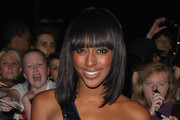 Alexandra Burke's Medium Straight Cut with Bangs