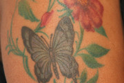Marsha Ambrosius Flower Tattoo