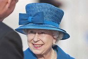 Queen Elizabeth II Wears an Aqua Blue Bow Hat