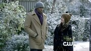 Cress Williams bundled up in the snow with this camel coat and purple scarf.