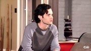 Penn Badgley masters the art of looking comfortable and pulled together in a two-tone crewneck sweater.