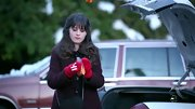 Zooey Deschanel chose a cranberry wool coat with black trim and button for her wintertime look on 'New Girl.'