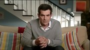 Ty Burrell layed up with this gray v-neck and crisp button-down.