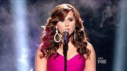 Skylar Laine looked glamorously feminine with full bombshell curls and oversize drop earrings.
