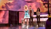 Hollie Cavanagh sang her parting song on 'AI' in summery white wedge sandals, tying together her sailor-inspired look.
