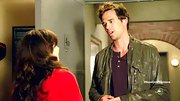 David Walton attempted to woo Zooey Deschanel on 'New Girl' in an olive collarless leather jacket.