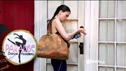 A distressed leather bag gives Sutton Foster's workout gear a distinguished touch.