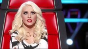 Christina Aguilera played up her retro beauty with red lips and curled bottle blond hair.