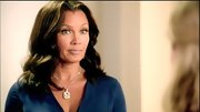 Vanessa Williams' dramatic diamond necklace added major impact to her sapphire wrap dress.