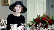 Laura Carmichael's character, Edith, looked so stylish in this wide brimmed black hat.