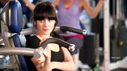 Heavy bangs keep Zooey Deschanel's ponytail sweet and polished at the gym.
