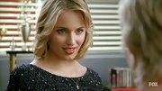 Dianna tinted her lips with a subtle red hue.