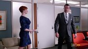 Christina Hendricks showcased her curves on 'Mad Men' in a dark floral sheath.