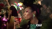 Dangling emerald green earrings topped off Freema Agyeman's Halloween look on 'The Carrie Diaries.'