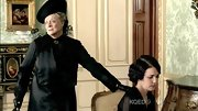 Maggie Smith topped off her black dress with a matching hat.