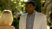 Check out Cress Williams' stylish layers! Try a chambray button-down under a white blazer for this charming look.