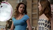 Margarita Levieva dressed up a simple aqua T-shirt with statement earrings and a long chain necklace.