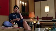 Bare legs balance the otherwise modest cut of Julia Ormond's royal blue sheath on 'Mad Men.'