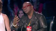 Randy Jackson boldly decided to inject color into his all-black attire with a pair of red plastic glasses and a candy-colored beaded necklace.