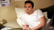 Jake Johnson looks super laid-back in his crisp white v-neck.