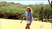 Emily Maynard was ready for a romp on the beach in a blue burn out top with a sexy cut-out back.